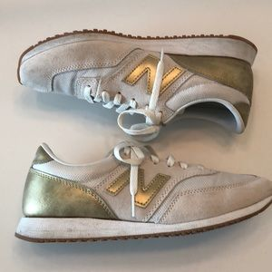 NEW BALANCE suede gold sneakers